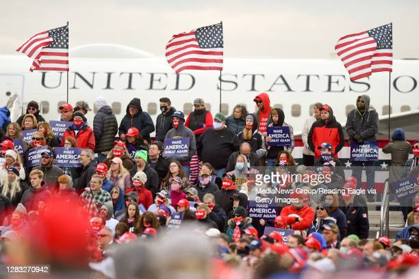 Supporters of President Donald J. Trump listen while he speaks. Behind them is Air Force One. At the Reading Regional Airport in Bern Township, PA...