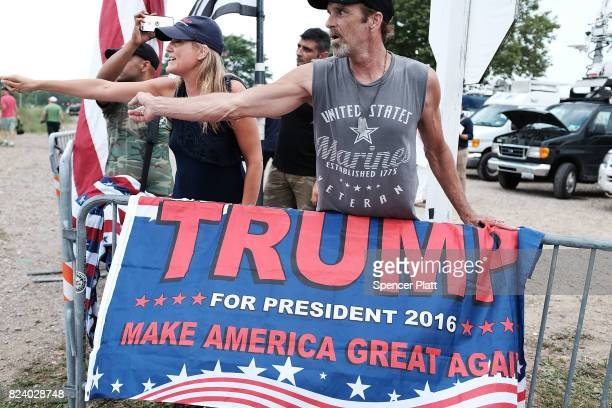 Supporters of President Donald Trump argue with anti Trump protesters outside of Suffolk Community College where President Trump was speaking on July...
