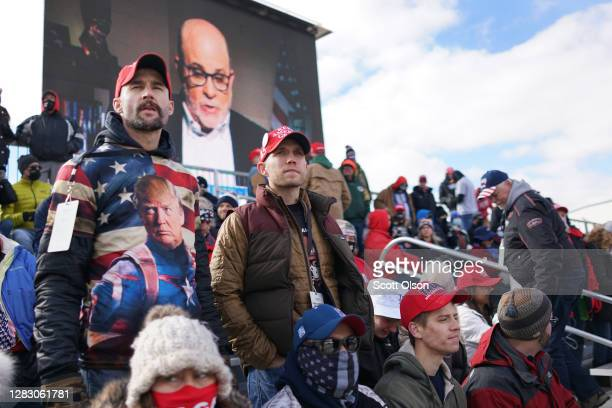 Supporters of President Donald Trump attend a campaign rally at GreenBay-Austin Straubel International Airport on October 30, 2020 in Green Bay,...