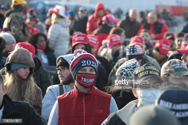 Supporters of President Donald Trump attend a campaign rally at the Waukesha County Airport on October 24, 2020 in Waukesha, Wisconsin. Trump is...