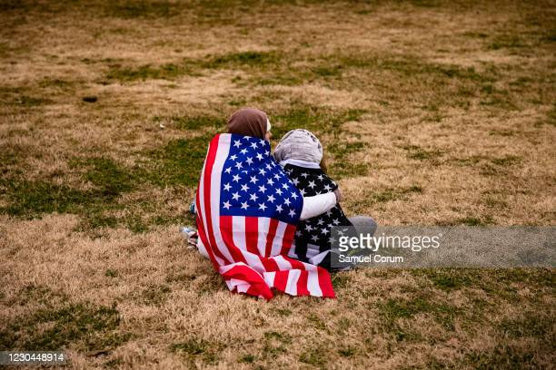 Supporters of President Donald Trump begin to gather on the lawn around the base of the Washington Monument on the National Mall on January 6, 2021...