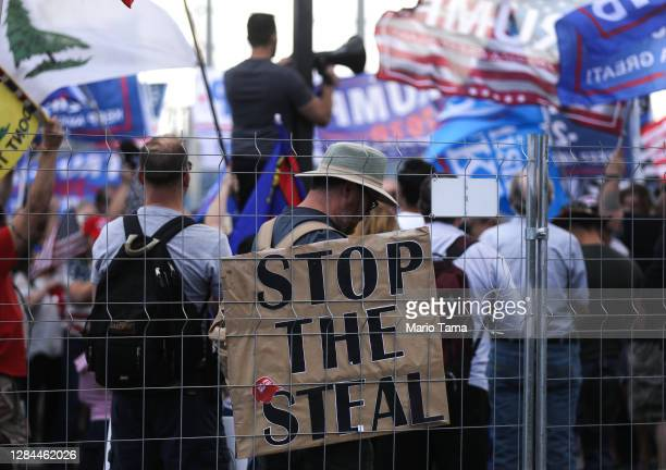 Supporters of President Donald Trump demonstrate at a 'Stop the Steal' rally in front of the Maricopa County Elections Department office on November...