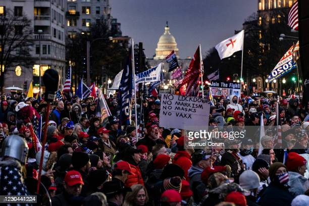 Supporters of President Donald Trump gather in the rain for a rally at Freedom Plaza on January 5, 2021 in Washington, DC. Today's rally kicks off...