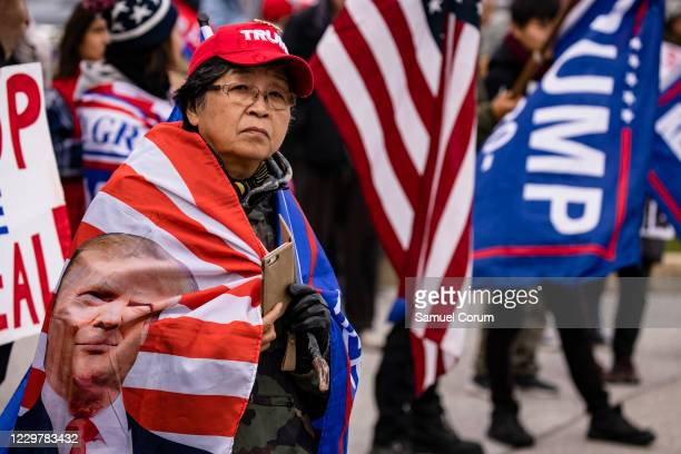 Supporters of President Donald Trump gather outside of the Wyndham Gettysburg hotel prior to a Pennsylvania Senate Majority Policy Committee public...