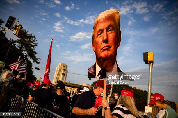 Supporters of President Donald Trump gather outside of Walter Reed National Military Medical Center after the President was admitted for treatment of...
