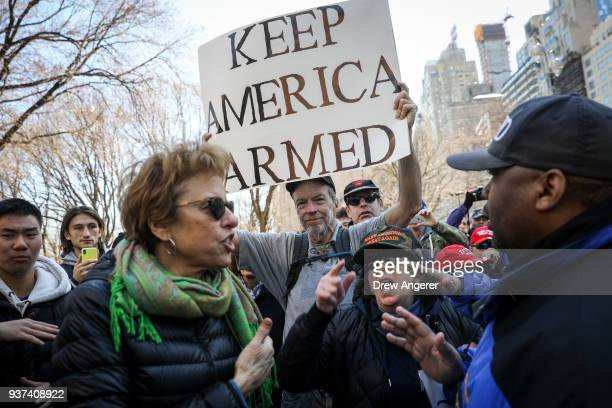 Supporters of President Donald Trump get into an argument with antigun activists during the March For Our Lives March 24 2018 in New York City...