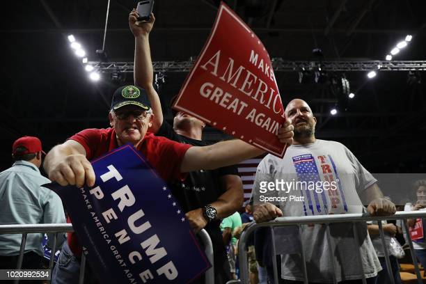Supporters of President Donald Trump jeer at the media during a rally on August 21 2018 in Charleston West Virginia Paul Manafort a former campaign...