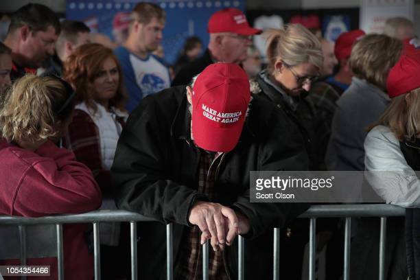 Supporters of President Donald Trump listen as the victims of today's shooting at the Tree of Life synagogue in Pittsburgh are remembered in prayer...