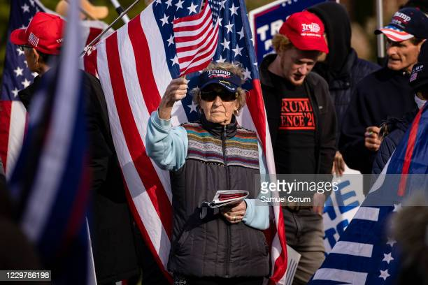 Supporters of President Donald Trump, most without masks, gather outside of the Wyndham Gettysburg hotel prior to a Pennsylvania Senate Majority...