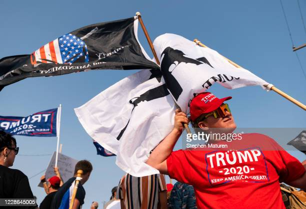 Supporters of President Donald Trump rally outside the Wisconsin Aluminum Foundry on September 21 2020 in Manitowoc Wisconsin Democratic presidential...