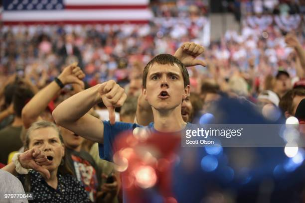 Supporters of President Donald Trump taunt the media after being egged on by the president during a campaign rally at the Amsoil Arena on June 20...