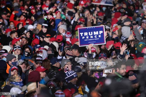 Supporters of President Donald Trump wait for the start of a campaign rally at the Waukesha County Airport on October 24, 2020 in Waukesha,...