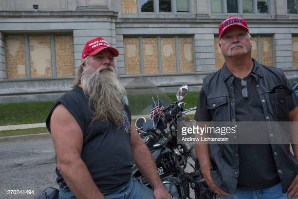 Supporters of President Donald Trump watch a small gathering of Black Lives Matter activists on September 1 2020 in downtown Kenosha Wisconsin...