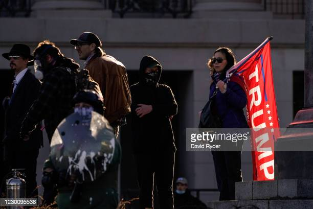 Supporters of President Donald Trump watch counter-protesters during a rally on December 12, 2020 in Olympia, Washington. Far-right and far-left...
