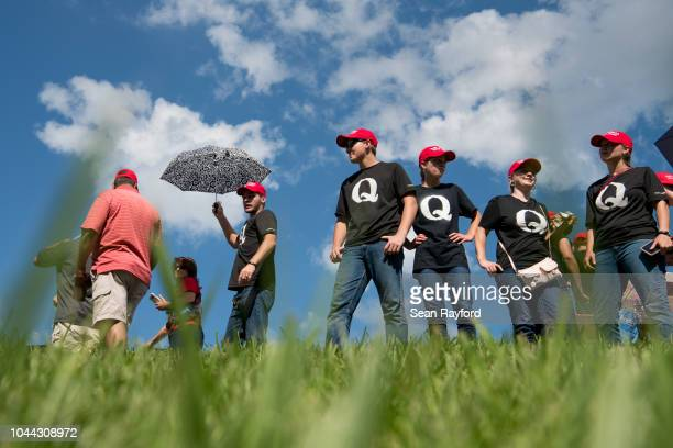 Supporters of President Donald Trump wearing 'QAnon' tshirts wait in line before a campaign rally at Freedom Hall on October 1 2018 in Johnson City...