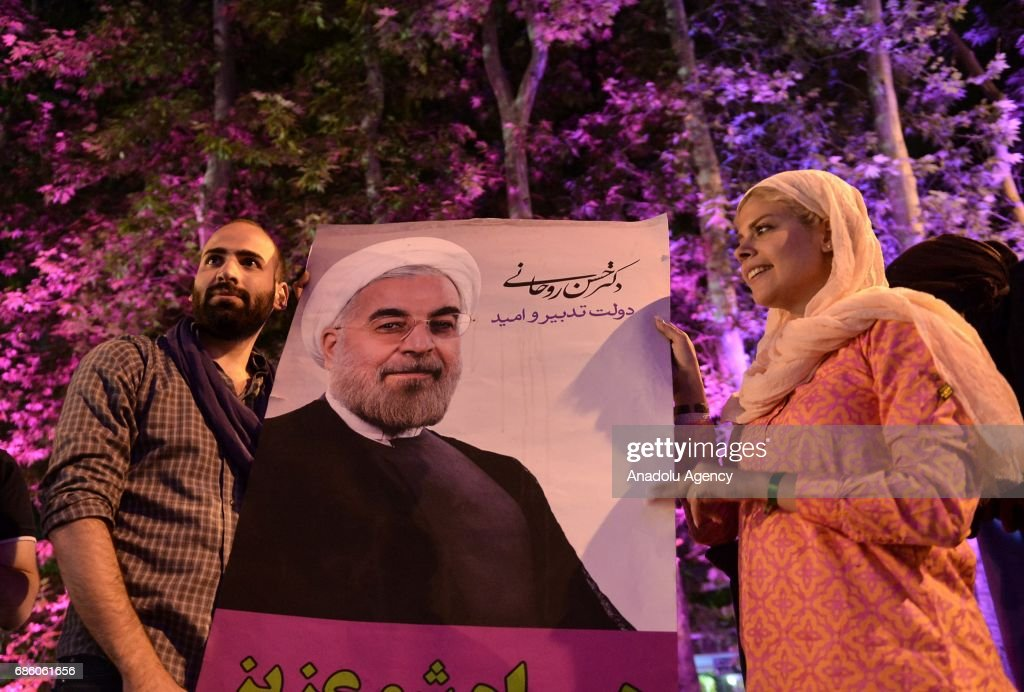 Supporters of President Hassan Rouhani celebrate after the results of the Iran vote were announced, in Tehran, Iran on May 20, 2017.