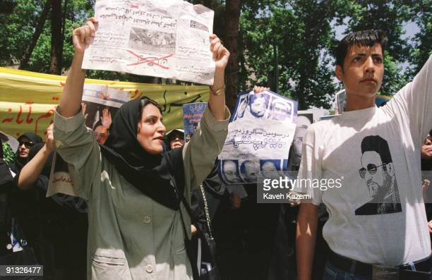 Supporters of president Mohammad Khatami carry his photograph and those of imprisoned journalists and thinkers on the third anniversary of his rise...
