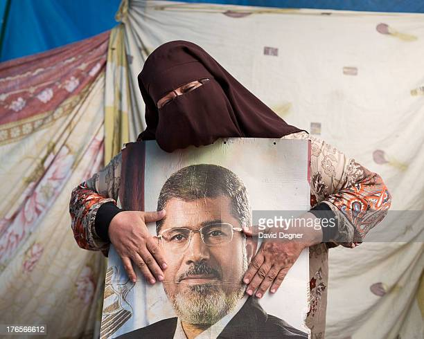 Supporters of president Morsi fill Rabaa Adwea in Cairo, Egypt on July 17, 2013. Awataf Mohamed Ibrahim, from Shubra, a neighborhood in Cairo, holds...
