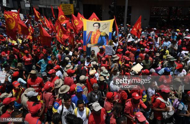 Supporters of President Nicolas Maduro display an image of South American Liberator Simon Bolivar during a May Day rally in Caracas on May 1 2019 Pro...