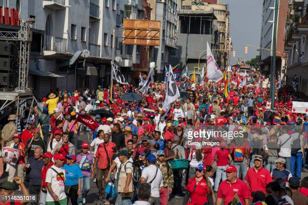 Supporters of president Nicolás Maduro march during a demonstration at Plaza O'Leary on May 01 2019 in Caracas Venezuela Yesterday Venezuelan...