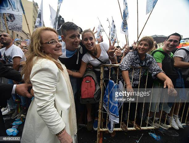 Supporters of President of Argentina Cristina Fernandez de Kirchner take pictures with Minister of Social Development Alicia Kirchner after the...