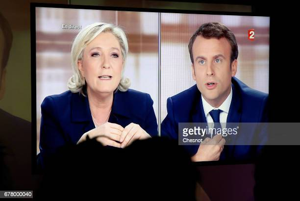 Supporters of President of the political movement 'En Marche ' and French presidential election candidate Emmanuel Macron watch the TV debate between...