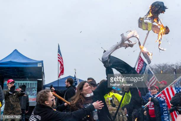 Supporters of President Trump burn an effigy of Oregon Governor Kate Brown on January 6, 2021 in Salem, Oregon. Trump supporters gathered at state...