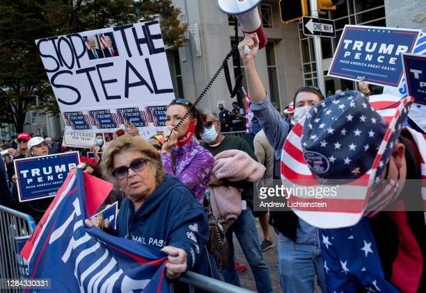 Supporters of President Trump gather outside the Pennsylvania Convention Center to protest mail in ballots being counted to determine the winner of...