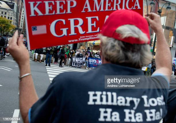 Supporters of President Trump hold a small rally and confront critics on October 24, 2020 in Herald Square, New York City. The two sides exchanged...