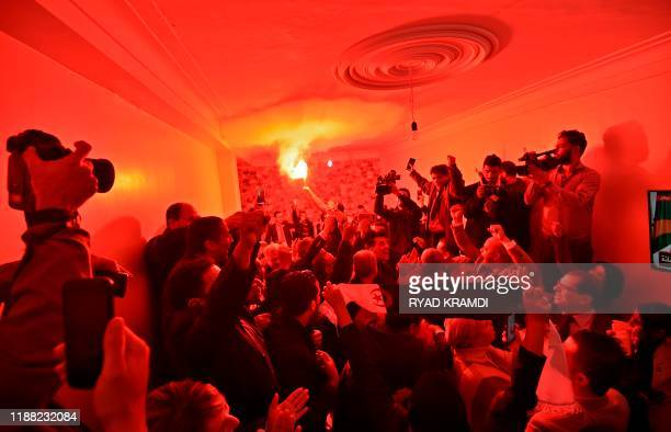 Supporters of presidential candidate Abdelmadjid Tebboune celebrate his victory in Algeria's presidential election in Algiers on December 13 2019...