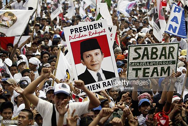 Supporters of Presidential candidate Amien Rais hold a banner to show their support at a large rally on June 26 2004 in the capital Jakarta Indonesia...