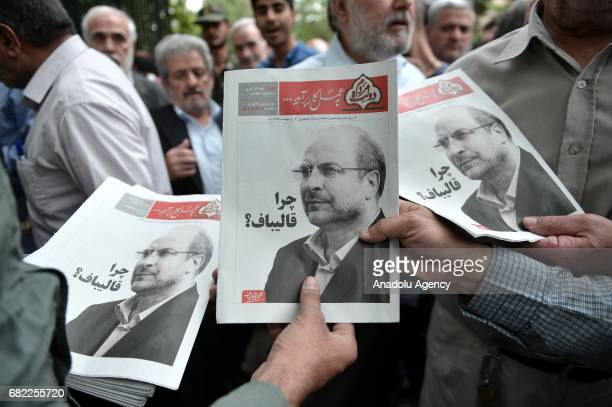 Supporters of presidential candidate and current Mayor of Tehran Mohammad Bagher Ghalibah distribute election brochures after the Friday Prayer in...