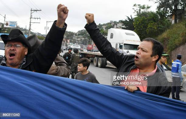 Supporters of presidential candidate for Honduras' Opposition Alliance against Dictatorship Salvador Nasralla hold a protest in Tegucigalpa on...