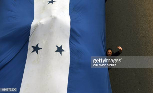 Supporters of presidential candidate for Honduras' Opposition Alliance against Dictatorship Salvador Nasralla hold a protest blocking the way out...