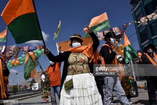 Supporters of presidential candidate for the Civic Community coalition, former president Carlos Mesa, take part in a campaign rally in El Alto,...