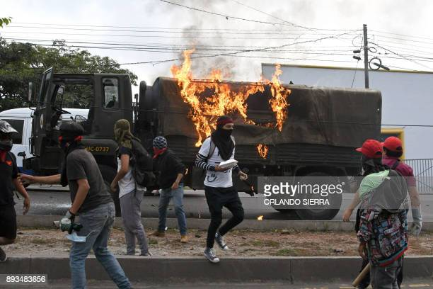 Supporters of presidential candidate for the Opposition Alliance against Dictatorship party Salvador Nasralla set alight an Honduran Army truck...