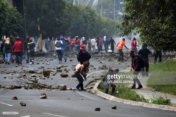 Supporters of presidential candidate for the Opposition Alliance against Dictatorship party Salvador Nasralla clash with Honduran Army soldiers...