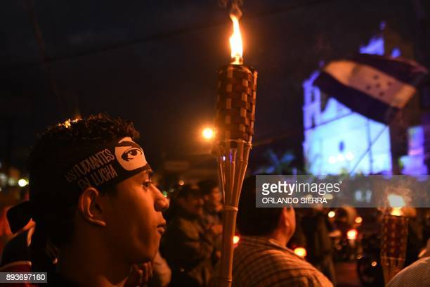 Supporters of presidential candidate for the Opposition Alliance against Dictatorship party Salvador Nasralla take part in a torch march in...