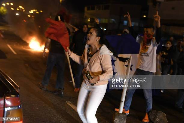 Supporters of presidential candidate for the opposition Alliance against Dictatorship party Salvador Nasralla, chant slogans as they protest in...