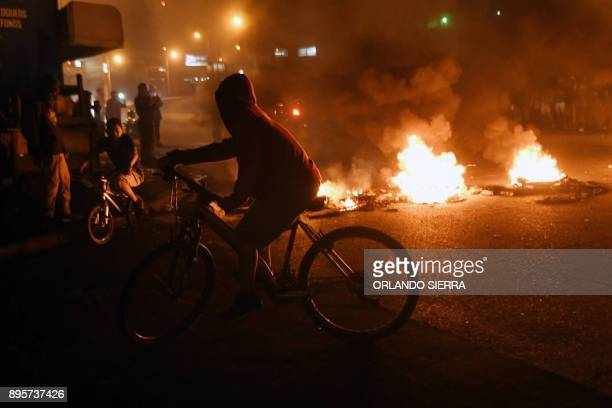 Supporters of presidential candidate for the opposition Alliance against Dictatorship party Salvador Nasralla set up burning barricades as they...