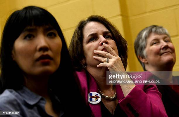 Supporters of Presidential candidate Hillary Clinton look on as they listen to former US President Bill Clinton speak during a campaign rally for his...