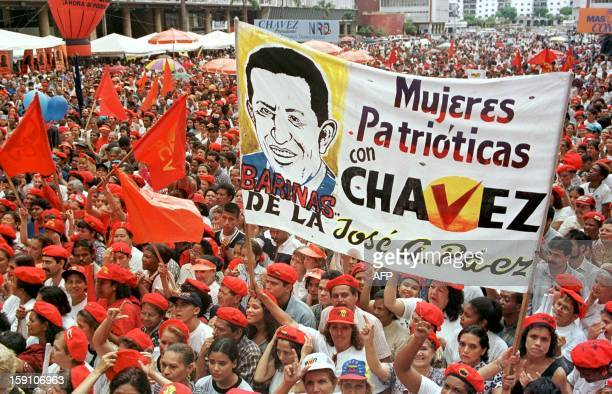 Supporters of presidential candidate Hugo Chavez Frias attend 03 October a rally in Caracas for the upcoming election 06 December Mas de 5000...