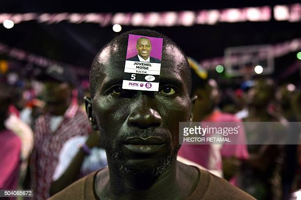 Supporters of presidential candidate Jovenel Moise of PHTK political party attend a rally in support of the candidate in the commune of Petion Ville...