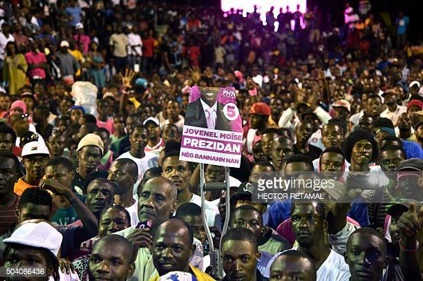 Supporters of presidential candidate Jovenel Moise of the PHTK political party attend a rally in the commune of Petion Ville PortauPrince on January...