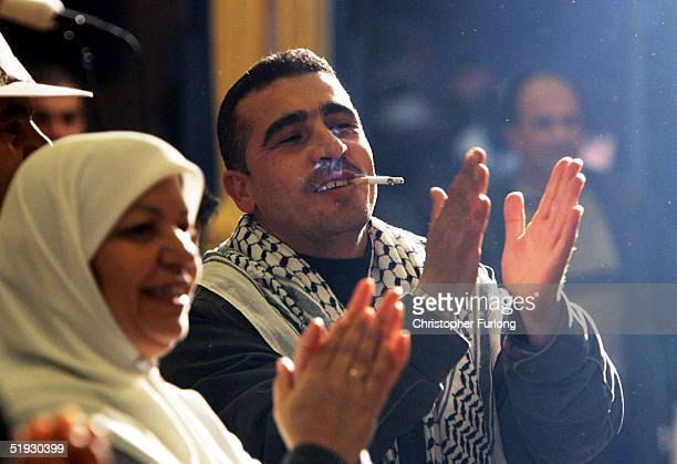 Supporters of presidential candidate Mahmud Abbas celebrate after he declared a victory January 9 2005 in Ramallah West Bank Exits polls showed Abbas...