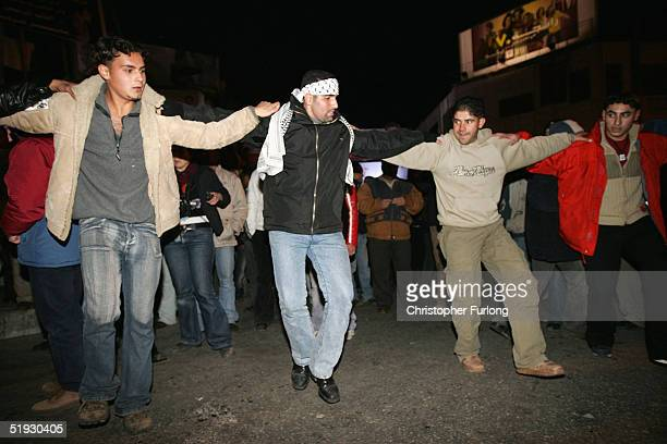 Supporters of presidential candidate Mahmud Abbas celebrate on the streets after he declared a victory January 9 2005 in Ramallah West Bank Exits...