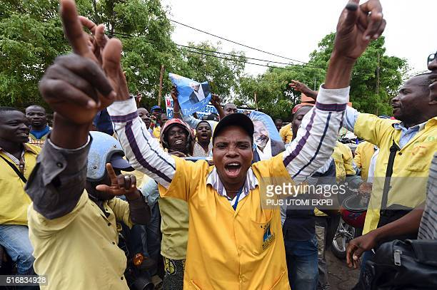 Supporters of presidential candidate Patrice Talon celebrate before the official announcement of the presidential elections results in Cotonou on...