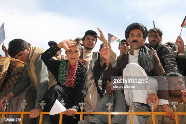 Supporters of presidential candidate Rassoul attend an election campaign even of the former Foreign Minister in Herat Afghanistan 30 March 2014 Photo...