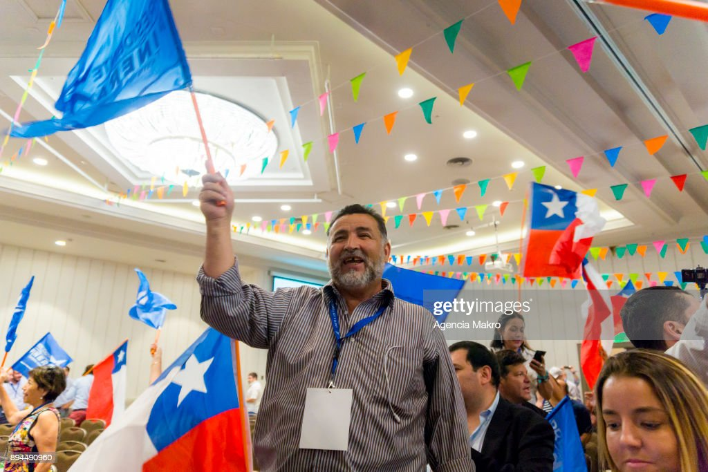 Supporters of presidential candidate Sebastian Piñera celebrate after the results of the second round of presidential elections in Chile on December 17, 2017 in Santiago, Chile.