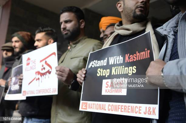 Supporters of proIndian political party National Confrence shout slogans during a protest against recent killings in the Kashmir conflict in Srinagar...